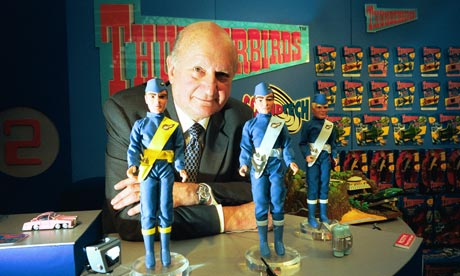 Gerry Anderson with some Thunderbirds figures in 2000. The Tracy brothers were named after US astronauts and fought evil from their International Rescue base on a south Pacific island. Photograph: Sean Smith for the Guardian